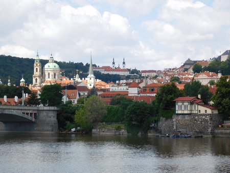 View of the city of Prague from the river bank