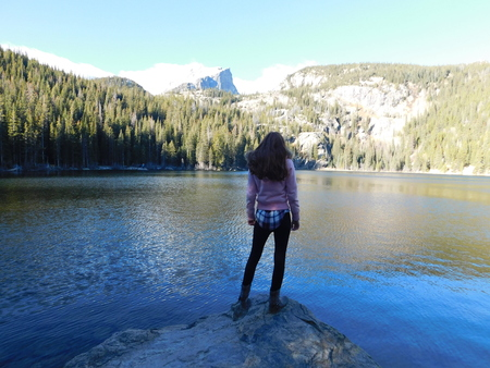 Young woman stand on the stone in bear lake