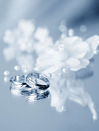 wedding rings with the white hair clip of the bride