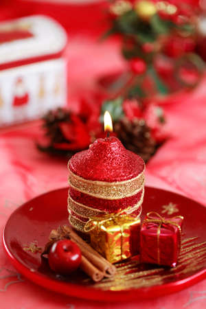 Festive tabletop or table decoration for Christmas time in red tone photo