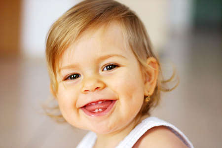 Small baby laughing on the bright background  Stock Photo