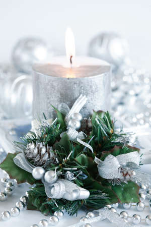 christmas motive: Festive candle as Christmas motive in silver and white tones Stock Photo