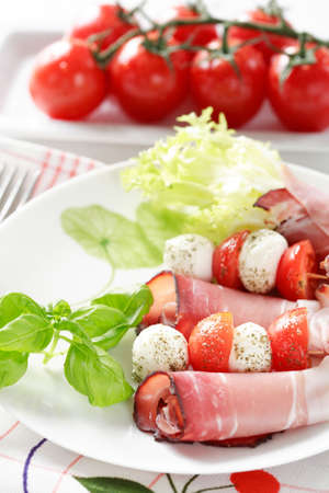 starter: Tomatoes and mozzarella with gammon as a starter