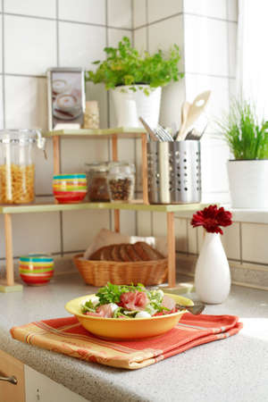 cooking implement: Kitchen interior with small shelf with pot-herb and kitchen implements Stock Photo