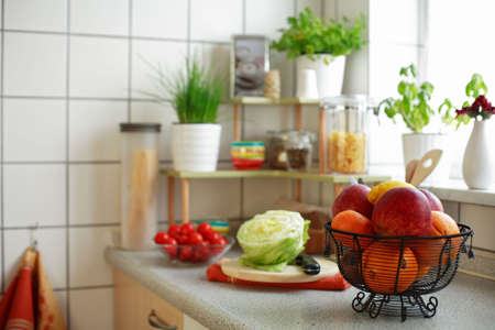 implements: Kitchen interior with small shelf with pot-herb and kitchen implements Stock Photo