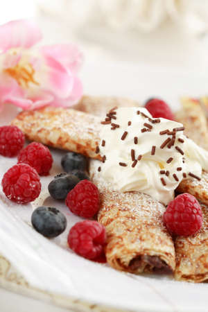 filled: Crepes filled with chocolate and fruits
