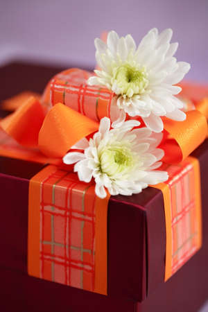 Present box with flowers photo