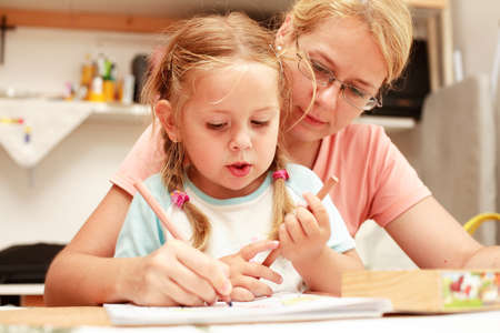 kiddies: Mother and child painting Stock Photo