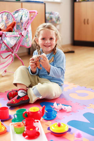 sincere girl: Cute girl playing with toys