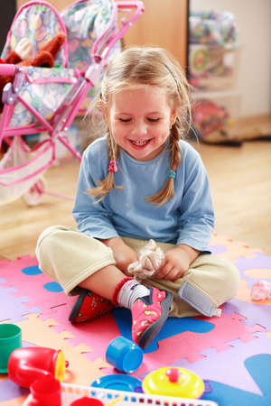 kiddies: Cute girl playing with toys