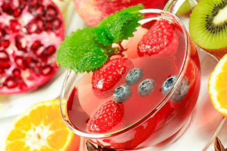 Winter fruit tea with fresh fruits photo