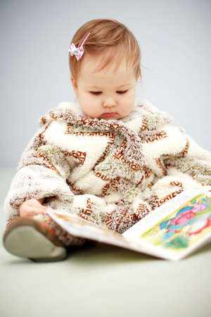 Small baby reading a book photo