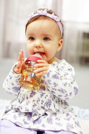 Cute baby is drinking tea Stock Photo
