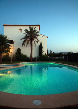 Villas with swimming pool by night photo