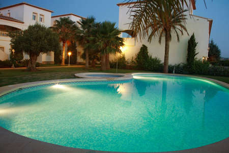 villas: Villas with swimming pool by night Stock Photo