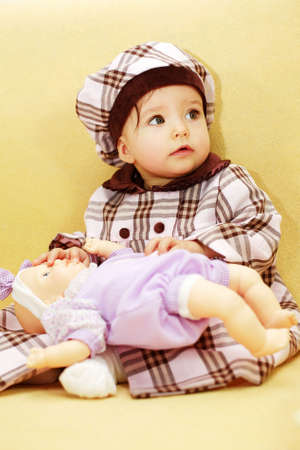 sincere girl: Cute baby with doll