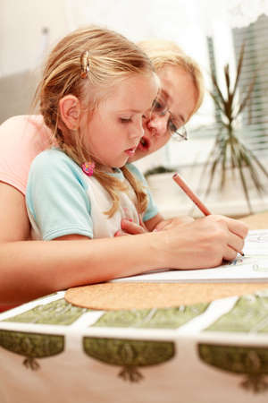 kiddies: Mother and child painting together Stock Photo
