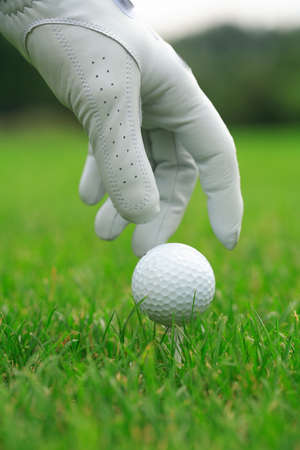 Detail of golf ball and gloves Stock Photo