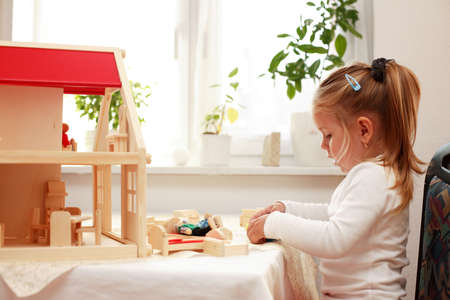Playing with dolls house photo