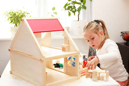 infants: Playing with dolls house