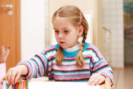 Cute little girl painting at home Stock Photo - 3665741