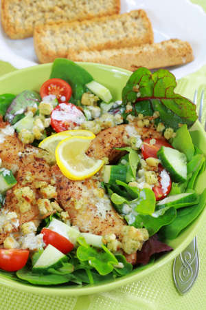stipe: Green mixed salad with chicken stripes and croutons