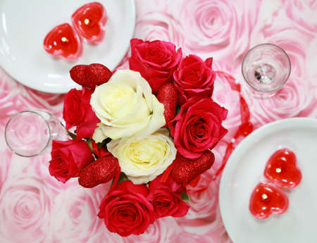 Table setting with rose bouquet for Valentine photo