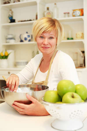 Woman cooking and baking in the kitchen photo