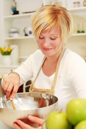Woman cooking and baking in the kitchen Stock Photo