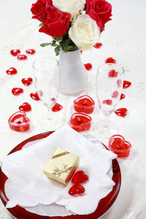 Still life with small hearts and candles for Valentine or other event photo