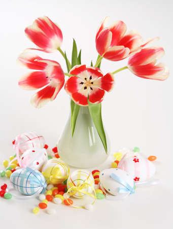 Home appliance - beautiful tulips in vase on the table with small Easter eggs Stock Photo - 4243581