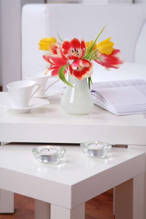 vase of flowers: Time for relaxing and reading - home interior in white tone