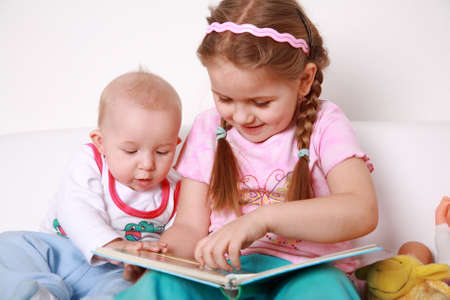 Cute kids reading book together Stock Photo - 4344295