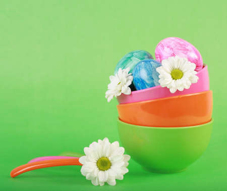 Photo of Easter eggs and flowers in the bowl photo