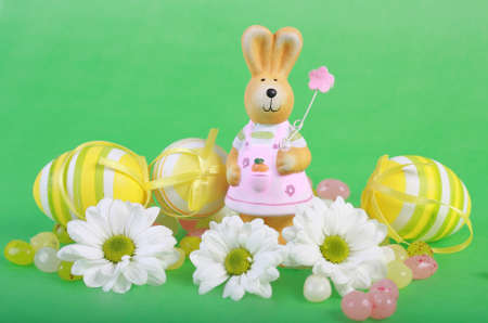 Easter bunny with eggs and flowers photo