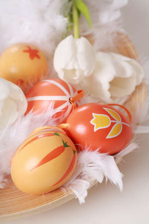 Table decoration for Easter with eggs and white tulips photo