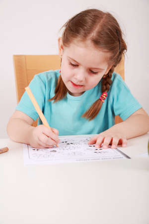 kiddies: Cute little girl painting at home