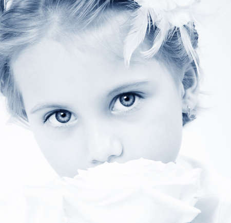Beautiful small girl with the rose  in blue tone Stock Photo - 4642931