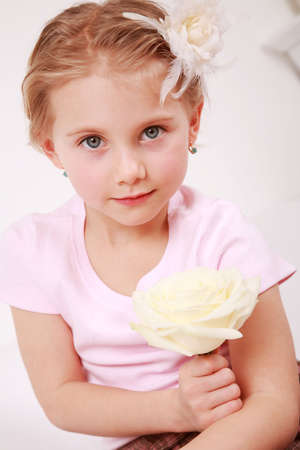 Beautiful small girl with the rose - for Mothers day photo