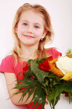 Cute girl with bouquet - for Mothers day photo