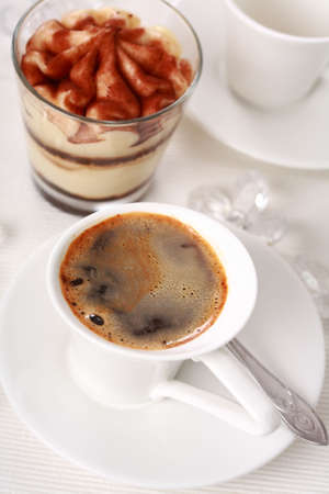 Detail of cup of coffee and dessert photo