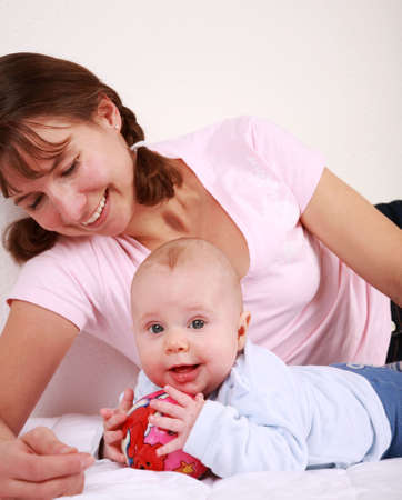 Family moments - Mother enjoying and playing with her cute baby Stock Photo - 4731095