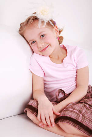 giggle: Beautiful small girl is smiling  sincerely  Stock Photo
