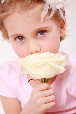 Beautiful small girl with the rose - for Mother's day Stock Photo - 4791317