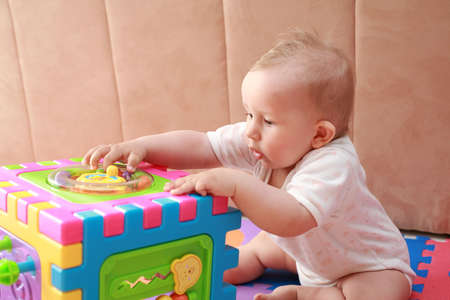 babycare: Cute baby playing with toy