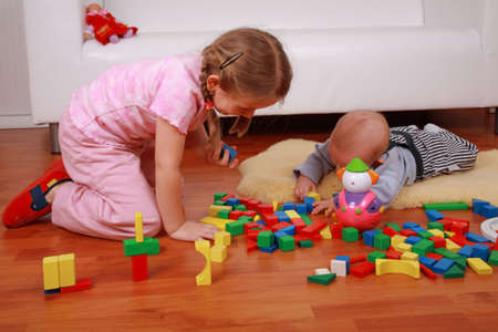 Adorable kids playing together with blocks Stock Photo - 4863657