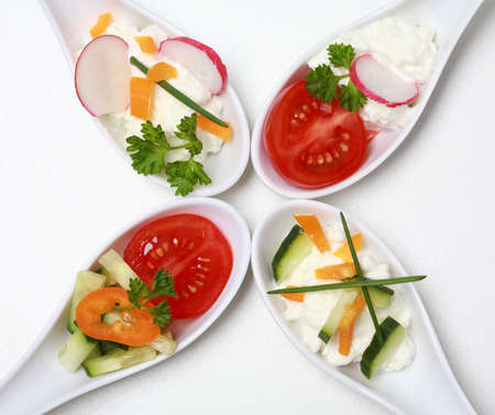 potage: Fingerfood served in small spoons Stock Photo
