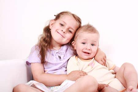 一緒に小さな弟とかわいい女の子 写真素材