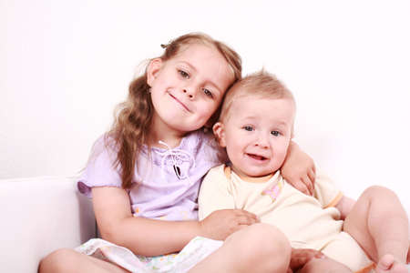 Cute little girl with her small brother together Stock Photo - 4938599