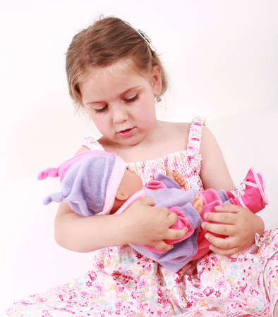 girl doll: Adorable girl playing with doll